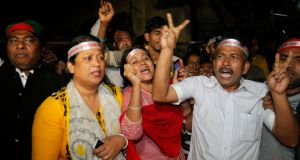 Bangladeshi activist shout slogans celebrating the execution of two war criminals Ali Ahsan Mohammad Mujahid of Jamaat-e-Islami and Salahuddin Quader Chowdhury of the Bangladesh Nationalist Party at the Central Jail in Dhaka, Bangladesh. Photograph: AP