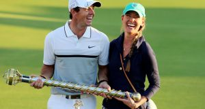 Rory McIlroy and his girlfriend Erica Stoll pose with the Race to Dubai Trophy after the final round of DP World Tour Championship European Tour. Ali Haider/EPA