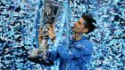 Serbia's Novak Djokovic celebrates with the trophy after winning the Barclays ATP World Tour Finals against Switzerland's Roger Federer. Photograph: Alex Morton/Reuters