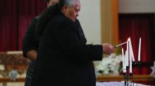 Jonah Lomu's mother, Hepi Lomu, lights a candle during a public memorial service for her son at Lotofalei'a Tongan Methodist Church. Photograph: Getty