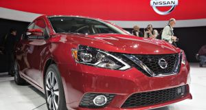 The Nissan  Sentra sits on stage during the Los Angeles Auto Show. Photograph: Daniel Acker/Bloomberg