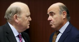 Michael Noonan and Spain's Luis de Guindos talking at a euro zone finance ministers meeting in Brussels on Monday.  Photograph: François Lenoir/Reuters