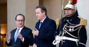 Co-ordination: French president Francois Hollande talks to British prime minister David Cameron after a meeting at the Elysée Palace in Paris. Photograph: Eric Gaillard/Reuters