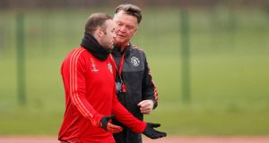 Manchester United's Wayne Rooney and manager Louis van Gaal speak during squad training. Photograph: Carl Recine/Reuters