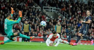 Mesut Özil opens the scoring for Arsenal in their Champions League Group F match against Dinamo Zagreb at  the Emirates Stadium. Photograph: Gerry Penny/EPA