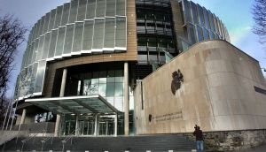 A couple who staged a car crash while pretending to be strangers were discovered when the insurance company saw that they appeared in each other's Facebook profile pictures, a court has heard.
