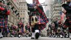 Bagpipers march during the St Patrick's Day parade in New York on March 17 of this year.  The board of directors behind the parade has complained to the New York State Attorney General about the alleged misuse of its funds dating back to 2010. Photograph: Jewel Samad/AFP/Getty Images.
