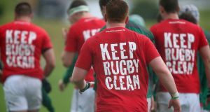 Irish players warm up in the Keep Rugby Clean IRB Anti-doping tee shirts before the 2014 Junior World Championship match between Fiji and Ireland. Photo: Jason Oxenham/Getty Images