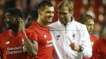 Liverpool manager Juergen Klopp celebrates with Dejan Lovren after their Europa League win over Bordeaux. Photo: Carl Recine/Reuters