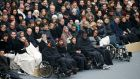 People wounded in the Paris attacks and family members attend a ceremony to pay a national homage to the victims of the Paris attacks at Les Invalides monument in Paris. Photograph: Charles Platiau/Reuters