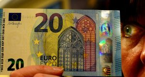 NEW MONEY: The new €20 note, pictured at the Central Bank. Photograph: Cyril Byrne/The Irish Times