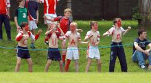 Young Cuala supporters cheer the camogie team on. Photograph: Donall Farmer/Inpho