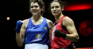 Katie Taylor (red) with Shauna O'Keefe (blue) at the end of their bout.