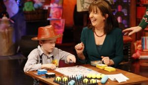 Weather fanatic Johnny O'Loughlin (8) from Ennis meets his hero meteorologist Evelyn Cusack. Photograph: Andres Poveda