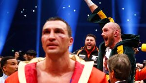 Tyson Fury celebrates after being declared the winner of the fight as Wladimir Klitschko looks dejected Photograph: Kai Pfaffenbach/Reuters