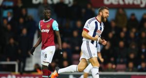Rickie Lambert of West Brom celebrates as his shot deflects off Winston Reid of West Ham for an equalising goal. Photograph: Richard Heathcote/Getty Images
