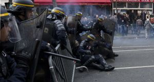 Members of riot police fall to the ground during clashes with protesters following a rally against global warming on November 29th, 2015 in Paris, a day ahead of the start of the UN conference on climate change (COP21). Photograph: Joel Saget/AFP/Getty Images