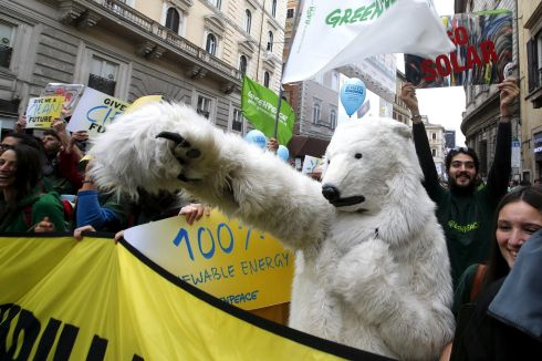 A protester dressed as a bear takes part in a rally held the day before the start of the 2015 Paris World Climate Change Conference in Rome. Photograph: Alessandro Bianchi/Reuters