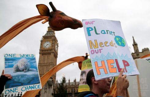 LONDON: Protesters at a rally held the day before the start of the Paris climate change summit, in London. Photograph: Suzanne Plunkett/Reuters