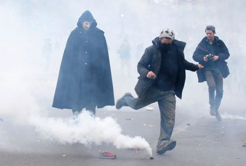 PARIS: A demonstrator kicks a tear gas canister during clashes with CRS riot police near the Place de la Republique. Photograph: Eric Gaillard/Reuters