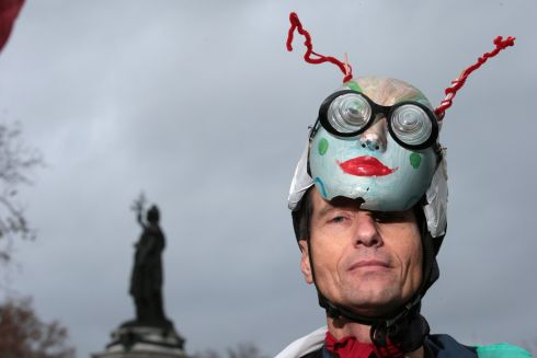 PARIS: A costumed protester poses during a rally against global warming in Paris. Photograph: Joel Saget/AFP/Getty Images