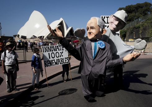 Giant puppets representing Australian Prime Minister Malcolm Turnbull (L) and his predecessor Tony Abbott parade in front of the Sydney Opera House during a rally held ahead of the 2015 Paris Climate Change Conference, known as the COP21 summit, in Sydney's central business district, Australia November 29, 2015.   REUTERS/Jason Reed
