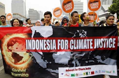 JAKARTA: People hold placards and banners during a march in Jakarta. Photograph: Garry Lotulung/Reuters
