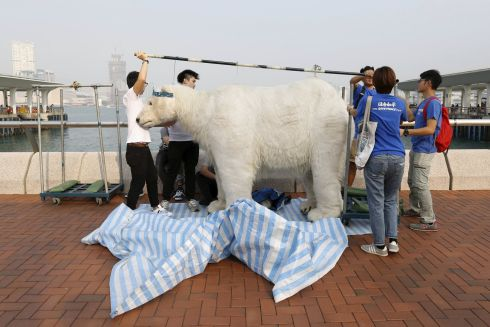HONG KONG: Protesters prepare a polar bear costume, during a march in  in Hong Kong ahead of the 2015 Paris Climate Change Conference. Photograph: Tyrone Siu/Reuters