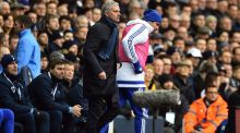 Chelsea striker Diego Costa passes José Mourinho as he warms up at White Hart Lane. Photograph: Ben Stansall/AFP Photo