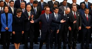 COP 21 GROUP: French president Francois Hollande (centre) with fellow world leaders during the opening day of the World Climate Change Conference 2015 at Le Bourget, near Paris. Photograph:Jacky Naegelen/EPA