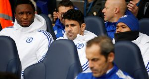 Chelsea's Diego Costa sits on the bench before the match against Tottenham. Photograph: Paul Childs/Reuters