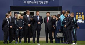 British Prime Minister David Cameron and Chinese President Xi Jinping during a visit to the City Football Academy in Manchester. Photograph: Joe Giddens/AFP/Getty Images
