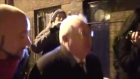 Bump in poles: protester hits lamp post confronting Joe Costello