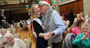 SENIOR CITIZENS: RCSI decks its halls as Rose of Tralee Elysha Brennan is welcomed by Paddy Pugh from Ranelagh, Dublin. Photograph: Maxwells