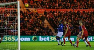 Romelu Lukaku scores the second goal for Everton. Photograph: Lee Smith/Reuters