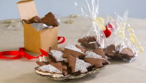 Roll out the cookie dough on a floured counter, and cut into Christmassy shapes. Photograph: Brownes photography