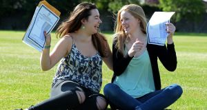 Mia Colleran and Shona Ní Aodhagain celebrate getting their Leaving Cert results at Coláiste Íosagáin, Stillorgan. Photograph: Eric Luke/The Irish Times