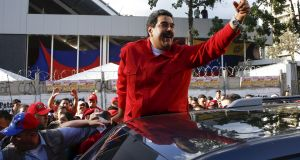 Venezuela's president Nicolás Maduro greets supporters after a meeting in the Petare district of Caracas. Photograph: Carlos Garcia Rawlins/Reuters