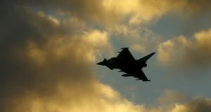 An RAF Typhoon plane flies above  southern Cyprus on Thursday. Photograph: Darren Staples