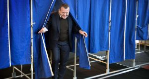 Danish prime minister Lars Lokke Rasmussen leaves the voting booth at Nyboder school in Copenhagen. Photograph: Nils Meilvang/AFP/Getty Images
