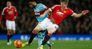 Manchester United's Bastian Schweinsteiger and West Ham's Alex Song battle for possession during the game at Old Trafford. Photograph: Lee Smith/Reuters.