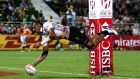 Jasa Veremalua scores a try for Fiji against England in the final of the Dubai Rugby Sevens on Saturday. Photograph: Warren Little/Getty Images.