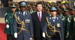 Chinese president Xi Jinping inspects a guard of honour  in Pretoria, where he announced a $60bn package for Africa. Photograph: EPA/Karel Prinsloo/Pool Chinese president Xi Jinping inspects a guard of honour in Pretoria, where he announced a $60bn package for Africa. Photograph: EPA/Karel Prinsloo/Pool