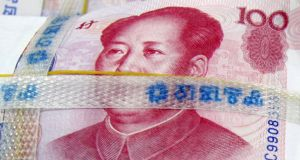 Chinese cash: The country has been loosening its grip on management of the yuan for a while. Photograph: REUTERS/Lee Jae-won