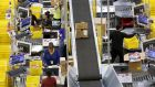 Workers at an Amazon warehouse: the company, one of the so-called four 'fang stocks', is a major reason why the S&P 500 was in the black in 2015.  Photograph: REUTERS/Fred Greaves