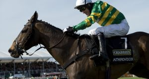 AP McCoy rides Shutthefrontdoor to fifth place at the 2015 Grand National. 'Being AP' is the new DVD which charts the jockey's remarkable 20-year career. Photo: Getty
