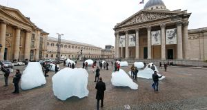 Visitors walk through ice blocks harvested in Greenland and installed on the Place du Pantheon for the COP21 world climate change conference. Photograph: Reuters/Benoit Tessier