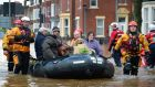 Rescue teams evacuate people from their homes after Storm Desmond caused flooding in Carlisle, England. Photograph: Jeff J Mitchell/Getty Images