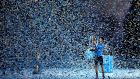 Novak Djokovic lifts the trophy following his victory during the men's singles final against Roger Federer at the Barclays ATP World Tour Finals. Photograph: Julian Finney/Getty Images