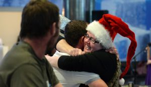 A smiling welcome home for Christmas at Dublin Airport last year. Photograph: Dara Mac Dónaill / The Irish Times